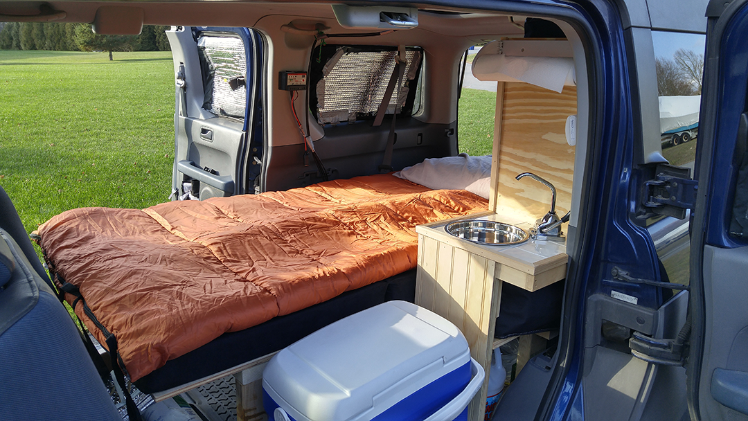 Van life in a Honda Element. This is a picture of the inside of my Element camper conversion!